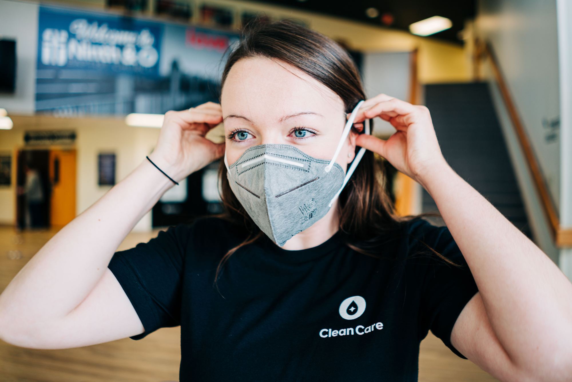 Clean Care worker putting on protective mask